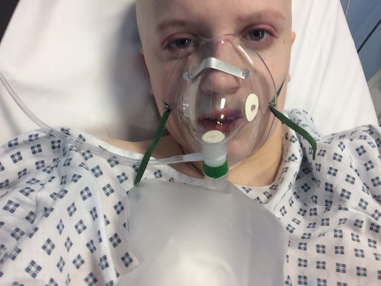 Natasha with an oxygen mask in hospital