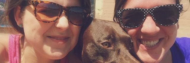 two women friends and a brown dog