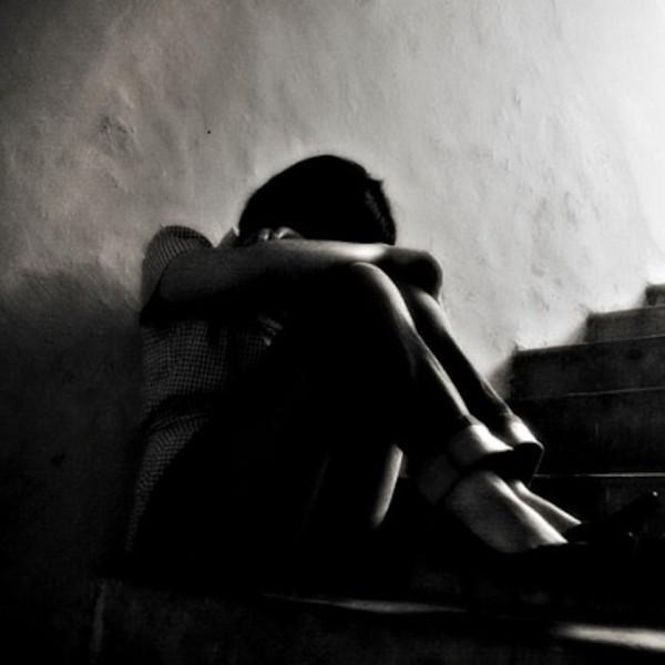 woman in dark corner