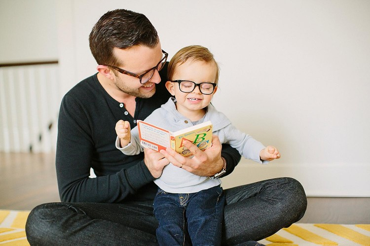 Jonas with his father wearing glasses and smiling