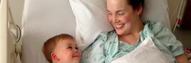 mother in hospital bed lying next to her son
