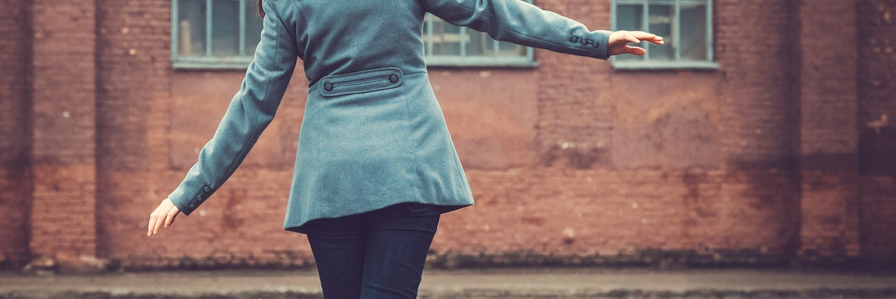 Girl walking on a railway