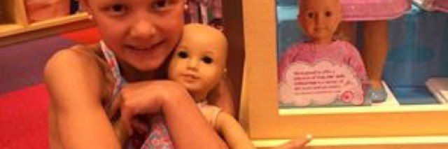 Mia Bailey and her bald doll