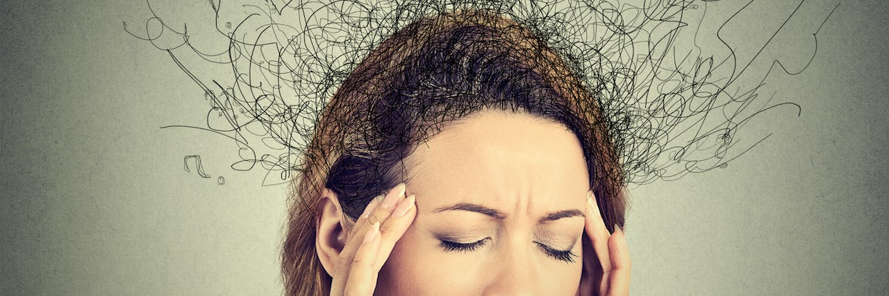 Woman with a stressed face, hands on temples, and lines coming from her head to indicate stress