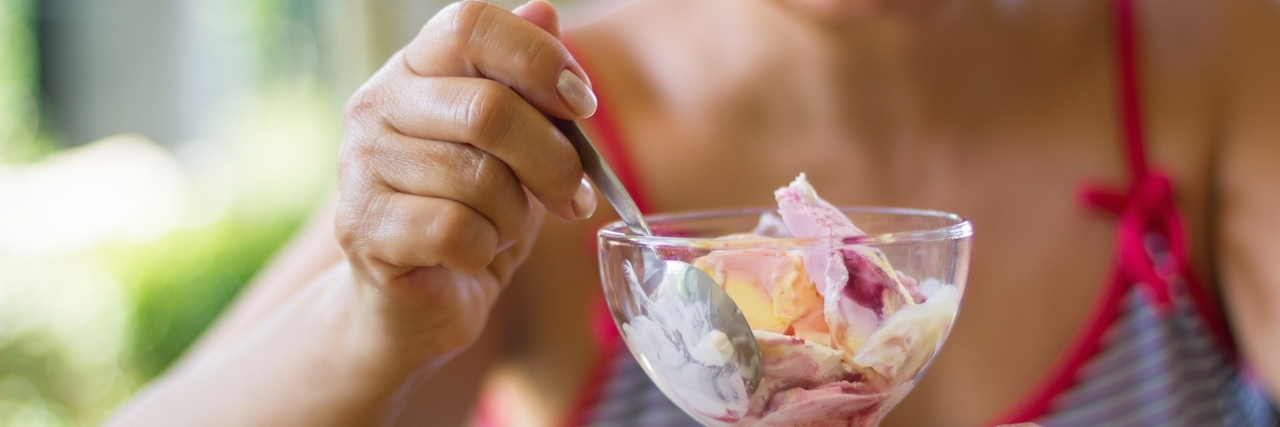 Woman on vacation eating ice-cream