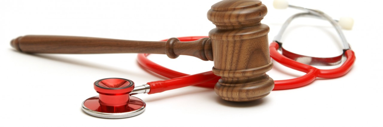 Wooden gavel and stethoscope
