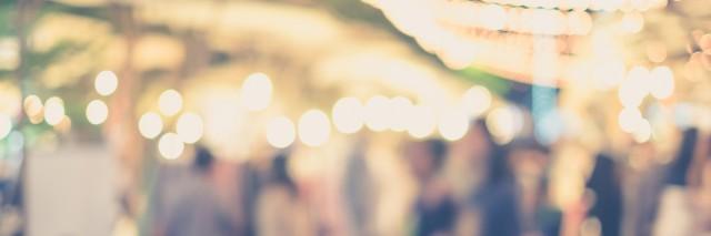 blurred people in street market