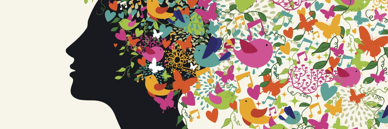 silhouette of woman with colorful birds and flowers coming out of her head