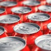 Macro view of color drink tin cans with cola soda beverage with selective focus effect