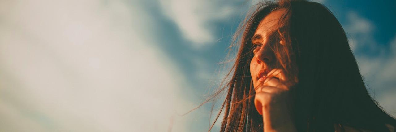 girl outside in a field