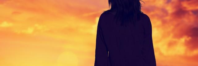 silhouette of girl watching sunrise