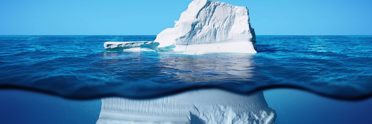 Underwater view of iceberg with beautiful transparent sea