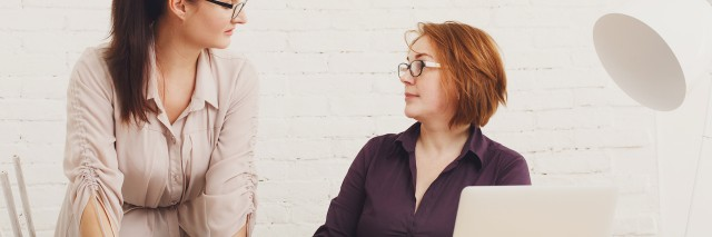 Conflict. Women discuss project in office