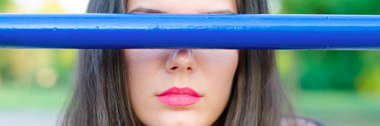 girl with a blue bar over her eyes