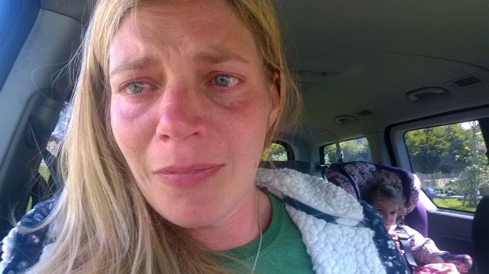 woman crying in her car