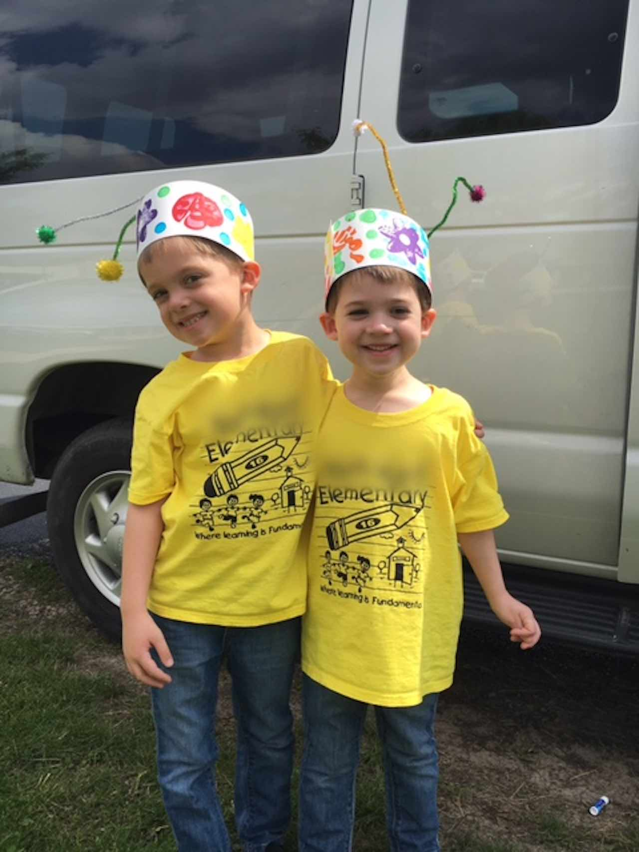 brothers smiling with bug hats on