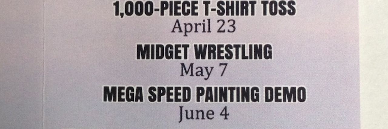 sign that advertises for midget wrestling