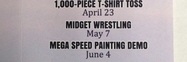 sign that advertises for midget wrestling
