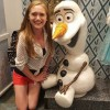 girl sitting with olaf character