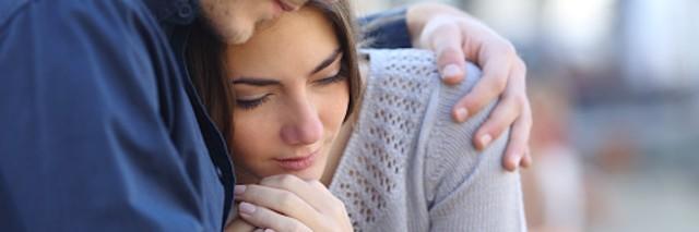 man comforts girlfriend