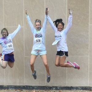 three women jumping in the air