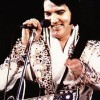 Elvis singing and smiling