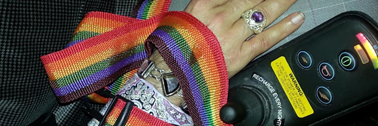 Felix's wheelchair, decorated with the rainbow flag.