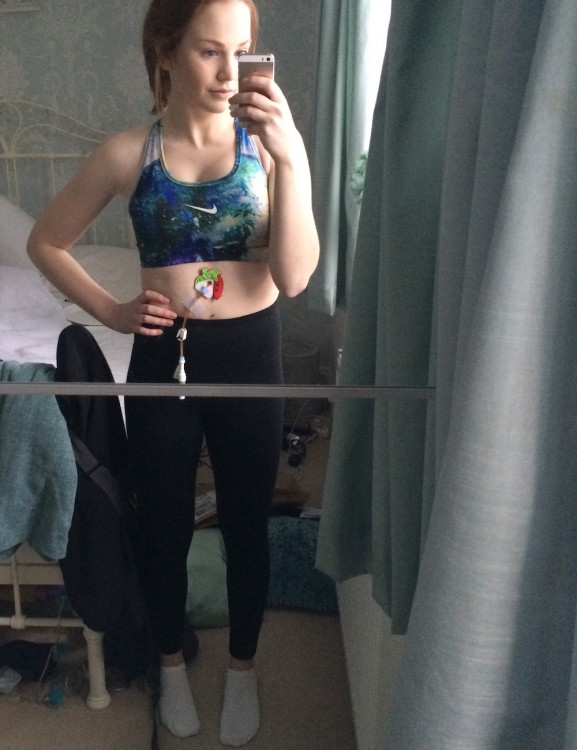 selfie of girl wearing a feeding tube and exercise clothes