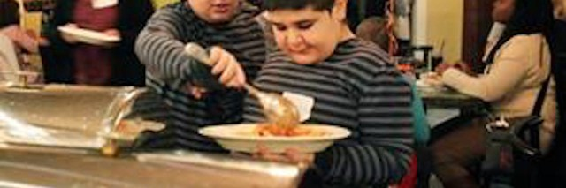 author's son with autism eating at a restaurant