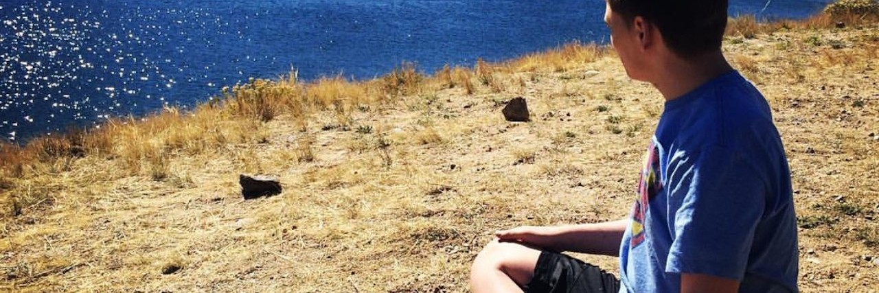 kreed looking at a lake