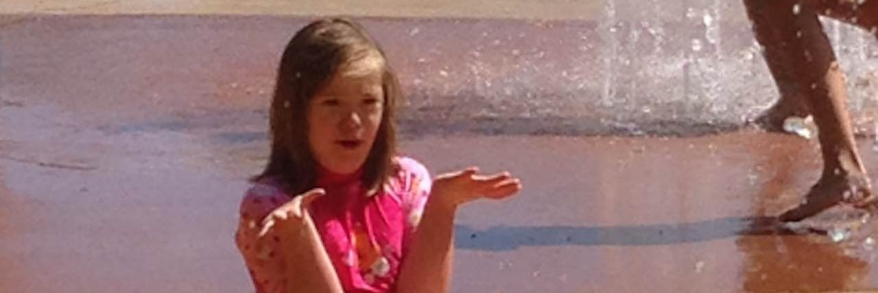 daughter with down syndrome playing at waterpark