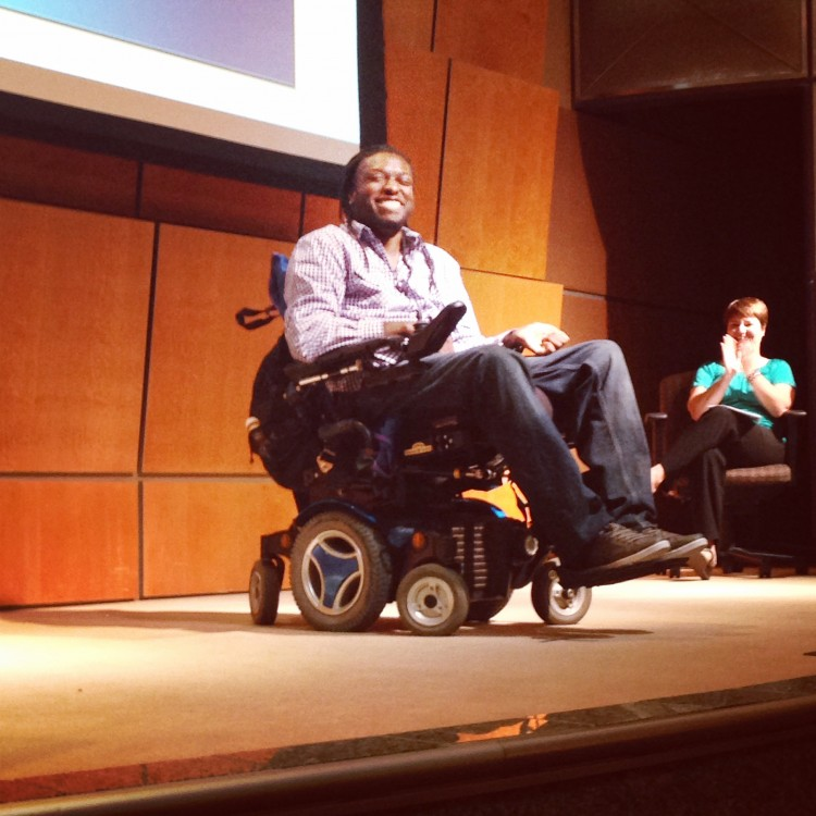 Nnaka giving a motivational speech while sitting in his wheelchair