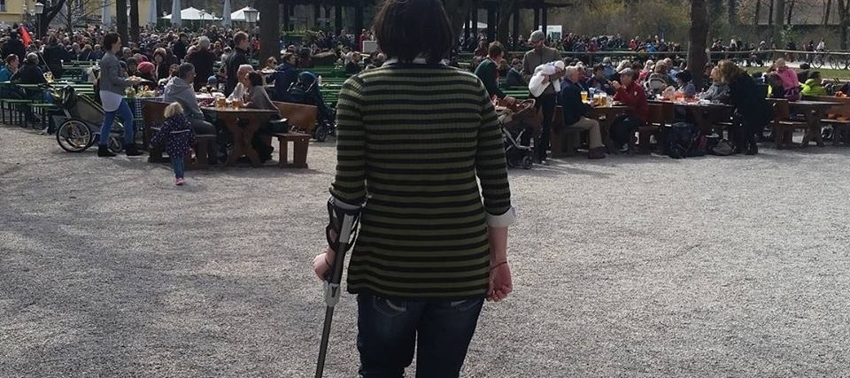 woman walking with crutch
