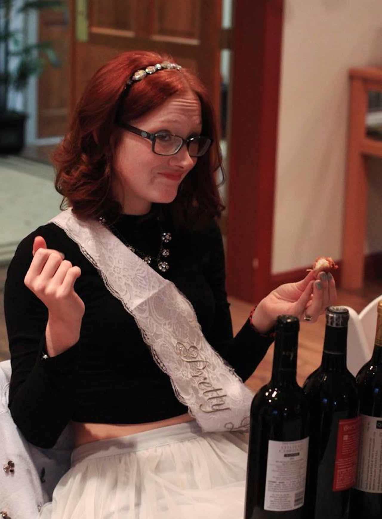 woman opening wine bottles