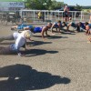 a group of runner doing pushups