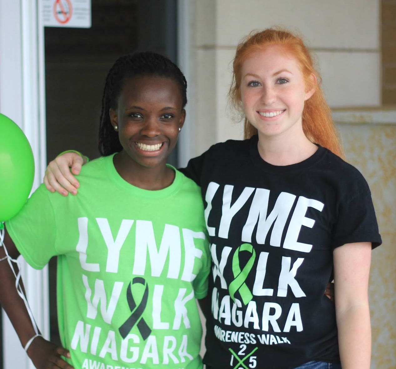 The author and her friend wearing Lyme Walk t-shirts