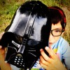 boy holding a darth vadar mask