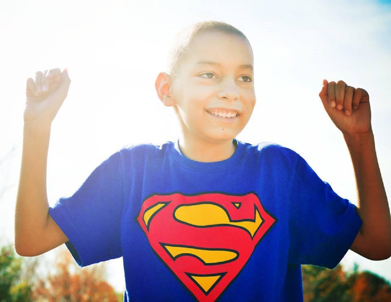 One of Stephanie Smith's photo subjects smiles in a Superman shirt.