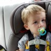 little boy in carseat