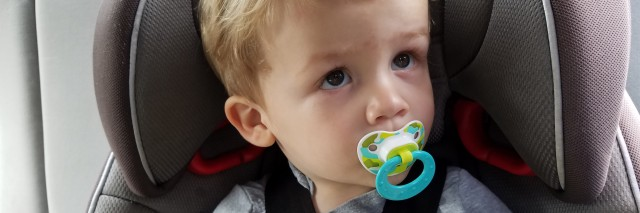 little boy in carseat