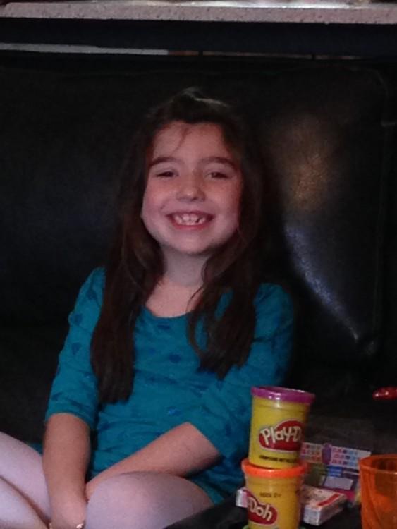 Cami's daughter smiling.