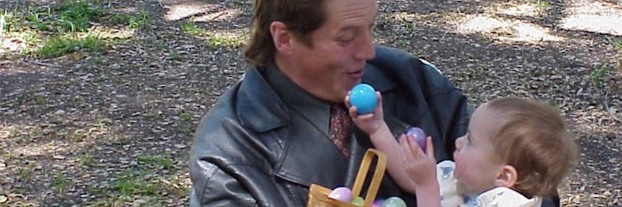 dad holding baby on easter