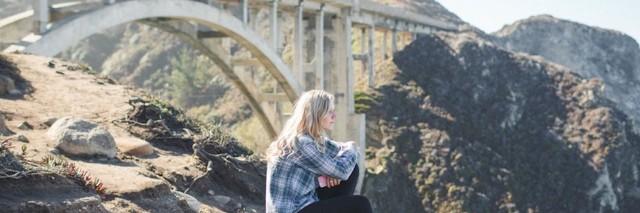 Fran Dargaville sitting near a bridge