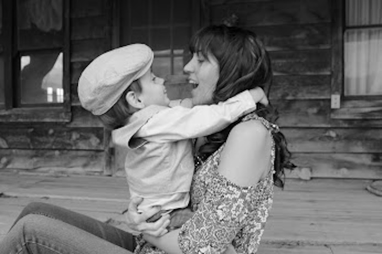 black and white photo of mom and son looking at each other