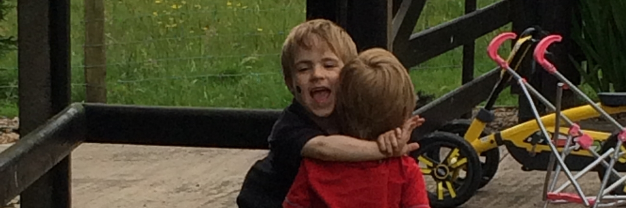 Claire's sons hugging outside