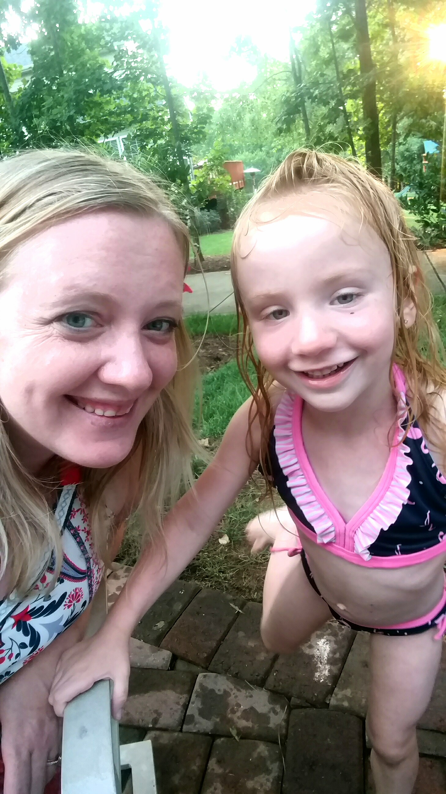 mom and little girl with autism at the pool