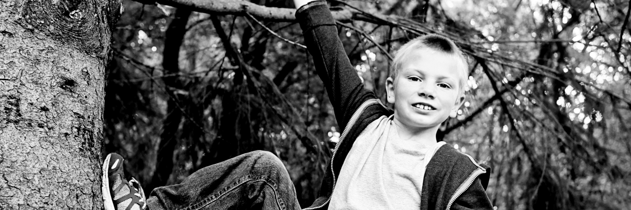 boy with autism climbing a tree
