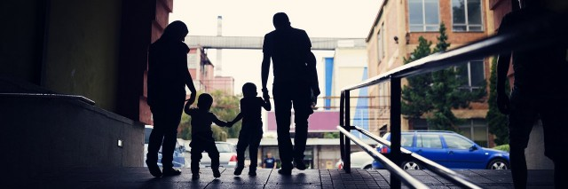 Young family walking together