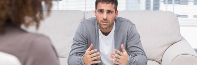 man talks to therapist in counseling session