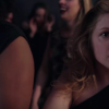blonde girl looking anxious at a party